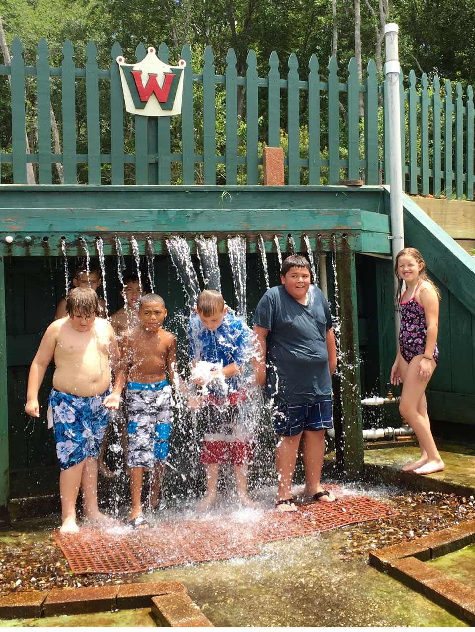 On a hot day, kids like to cool off at The Waterfall